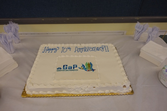 "a cake with ""happy 10th anniversary dbGaP"" written on it"